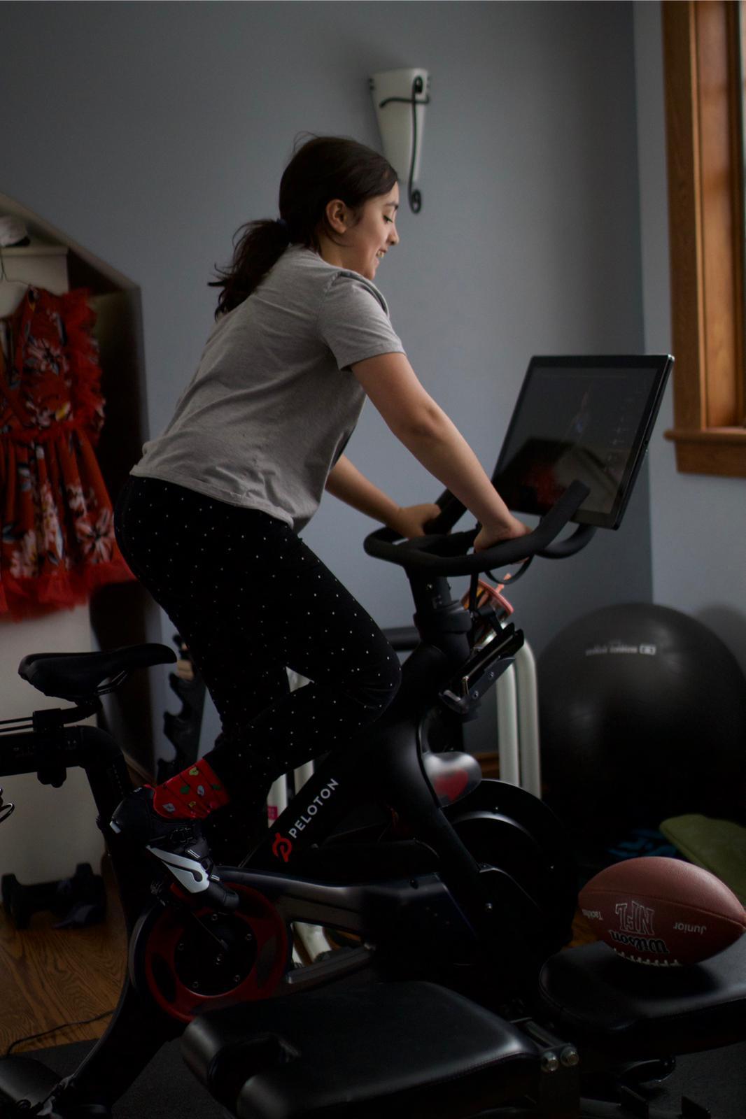 Daughter using Pelaton Bike